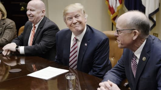 President Donald Trump, center, smiles as Representative Greg Walden, a Republican from Oregon, right, and Representative Kevin Brady, a Republican from Texas, sit during a discussion on health care in the Roosevelt Room of the White House in Washington, D.C. U.S., on Friday, March 10, 2017.