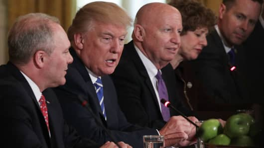 President Donald Trump (2nd L) speaks as House Majority Whip Rep. Steve Scalise (R-LA) (L), Rep. Kevin Brady (R-TX) (3rd L) and other House members listen during a meeting with the House Deputy Whip team at the East Room of the White House March 7, 2017 in Washington, DC.