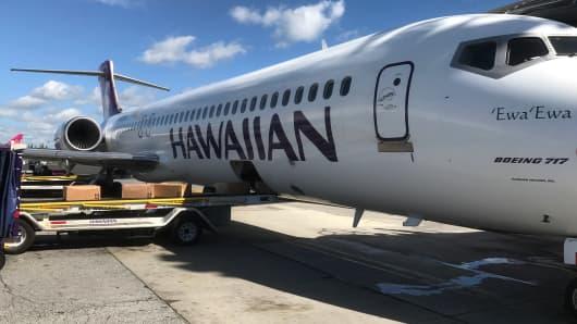 A Hawaiian Airlines airplane on the tarmac in Honolulu, Hawaii.