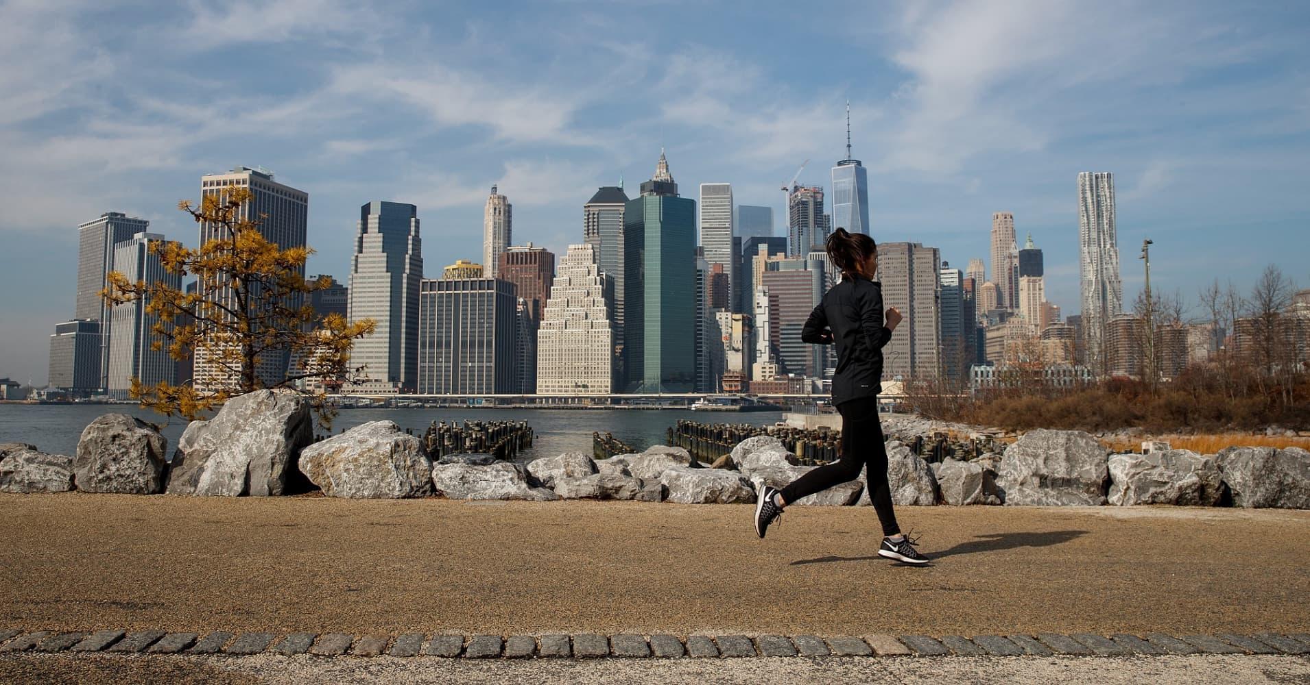 A jogger runs along the Brooklyn Bridge Park
