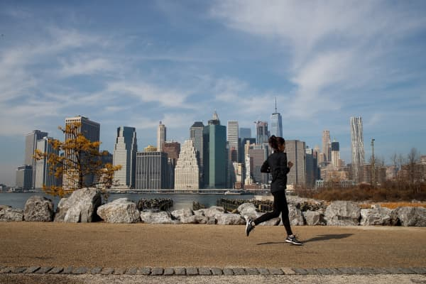 A jogger runs along the Brooklyn Bridge Park