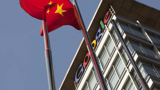 A Chinese flag flies outside the Google China headquarters in Beijing, China, on Tuesday, Dec. 7, 2010.