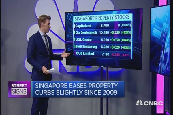 Singapore eases property curbs