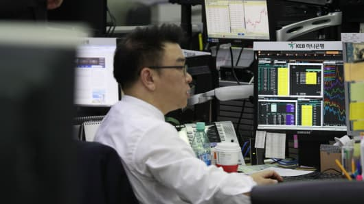 A currency trader at the foreign exchange dealing room of the KEB Hana Bank headquarters in Seoul, South Korea