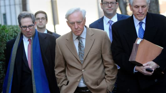 Billy Walters, professional gambler and owner of Walters Golf, center, exits following a pretrial hearing at federal court with his attorneys in New York, on Thursday, March 2, 2017.