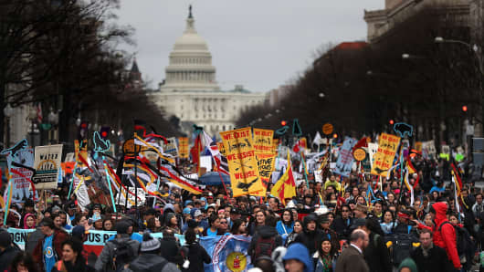 Protesters march during a demonstration against the Dakota Access Pipeline on March 10, 2017 in Washington, DC.