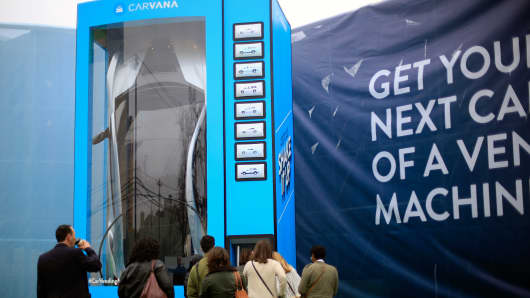 People try their luck at winning a car from the Carvana vending machine at SXSW festival in Austin, Texas on March 12, 2016.