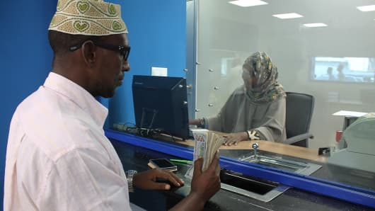 A customer at a bank in Mogadishu, Somalia on June 7, 2015.