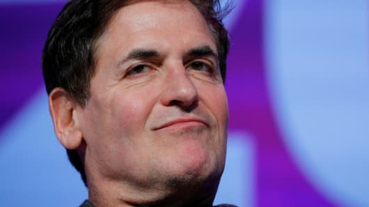 Businessman Mark Cuban listens as he is introduced at the South by Southwest (SXSW) Music Film Interactive Festival 2017 in Austin, Texas, March 12, 2017.