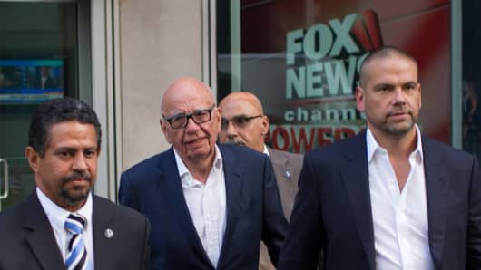 Rupert Murdoch leaves the News Corporation building with his son Lachlan Murdoch (R) on July 21, 2016 in New York City.