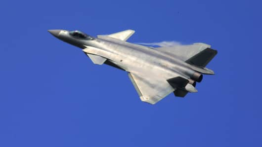 A J-20 stealth fighter of China flies at the 11th China International Aviation and Aerospace Exhibition in Zhuhai, south China's Guangdong Province, Nov. 1, 2016.