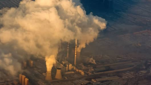 An aerial view of chimneys billowing out smoke and steam on December 17, 2016 in Changchun, China.