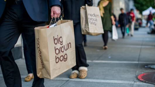 Pedestrians carry Bloomingdale's shopping bags in San Francisco.