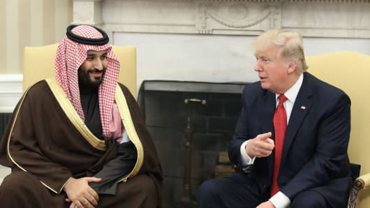 U.S. President Donald Trump, speaks with Mohammed bin Salman, the Kingdom of Saudi Arabia's deputy crown prince and minister of defense, left, in the Oval Office of the White House in Washington, D.C., U.S., on Tuesday, March 14, 2017.