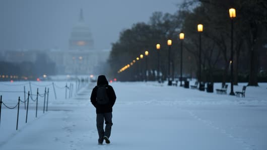 A pedestrian walks towards the U.S. Capitol during a nor'easter that blanketed the area with snow and sleet on Tuesday March 14, 2017 in Washington, DC.