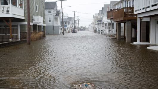A sewage drain is seen intaking large quantities of garbage and water at the end of Beach Street on March 14, 2017 in Sea Bright, New Jersey. Due to high winds, tidal waters from the Shrewsbury River are expected to remain several feet above regular high tide levels throughout the day.