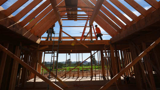 Construction workers build a single-family home in San Diego.