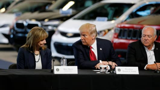 President Donald Trump talks with auto industry leaders, including General Motors CEO Mary Barra (L) and United Auto Workers (UAW) President Dennis Williams (R) at the American Center for Mobility in Ypsilanti Township, Michigan, U.S. March 15, 2017.