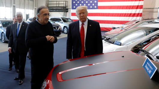 President Donald Trump tours new cars with auto industry leaders, including Fiat Chrysler CEO Sergio Marchionne (L), at the American Center for Mobility, a test facility for driverless car technology for American Manufactured Vehicles in Ypsilanti Township, Michigan, U.S. March 15, 2017.