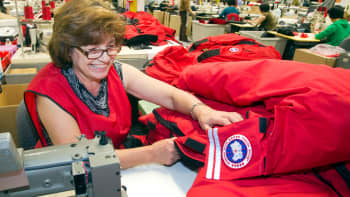 A seamstress for Canada Goose, pieces together outerwear on the manufacturing floor of the company's facility in Toronto.