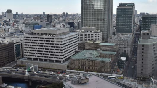 This picture taken on February 6, 2017 shows the Bank of Japan headquarters (C).