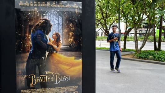 A poster for the film 'Beauty and the Beast' is displayed in Singapore on March 14, 2017.