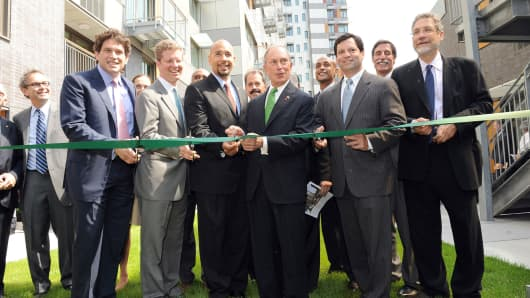 In this 2012 file photo, then-Mayor Michael Bloomberg joins Obama administration HUD Secretary Shaun Donovan at the grand opening of the Via Verde affordable housing development in the Bronx.
