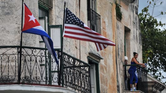 Cuban and US flags are seen on balconies in Havana