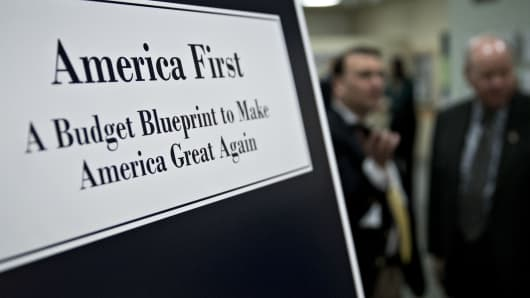 Us aggressively defends america first agenda ahead of trumps a poster of us president donald trumps fiscal 2018 budget request america first a malvernweather Images