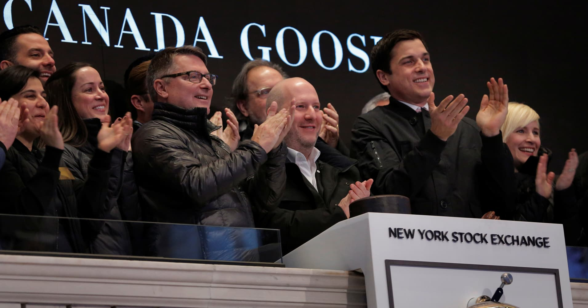 Canada goose closes its first day trading up more than 25 ceo of canada goose dani reiss applauds the companys ipo above the floor of the new biocorpaavc