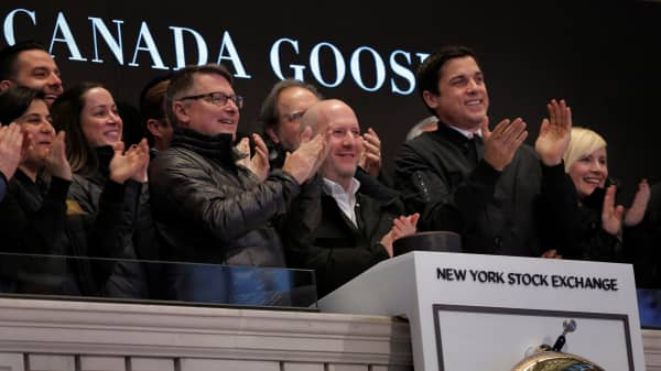 CEO of Canada Goose Dani Reiss applauds the company's IPO above the floor of the New York Stock Exchange (NYSE) shortly after the opening bell in New York, U.S., March 16, 2017.