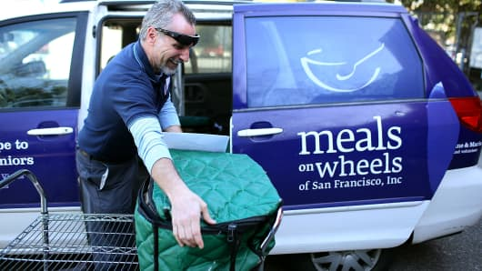 A Meals On Wheels of San Francisco driver loads meals into a van before making deliveries in San Francisco, California.
