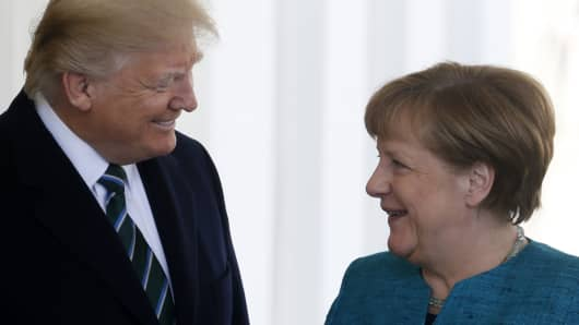 President Donald Trump greets German Chancellor Angela Merkel at the White House in Washington, U.S., March 17, 2017.