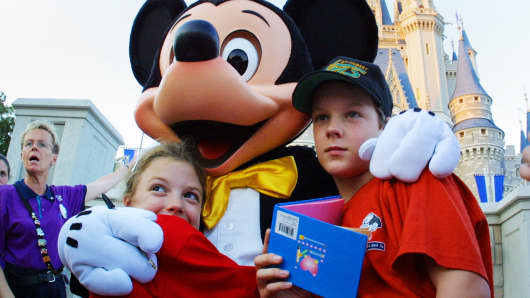 The Walt Disney character Mickey Mouse greets children at Magic Kingdom in Orlando, Florida.