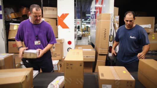 Employees sort through items being shipped through the FedEx World Service Center in Doral, Florida.