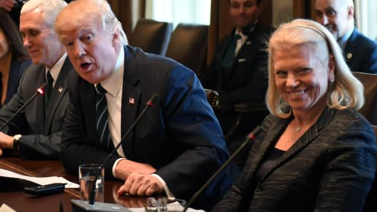President Donald Trump speaks, flanked by Vice President Mike Pence (L) and IBM CEO Virginia Marie 'Ginni' Rometty (R) during a roundtable discussion on vocational training with United States and German business leaders lead in the Cabinet Room of the White House on March 17, 2017 in Washington, DC.