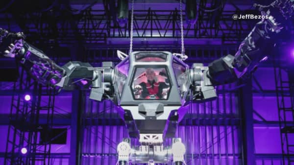 Jeff Bezos Looks A Little Too Happy Piloting A Giant Mechanical Robot