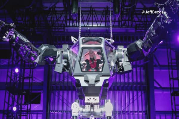 Jeff Bezos takes a ride in a 13-foot robot