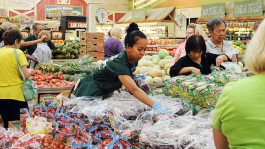 An employee stocks cherries at Sprouts Farmers Market in Wheat Ridge, Colorado.