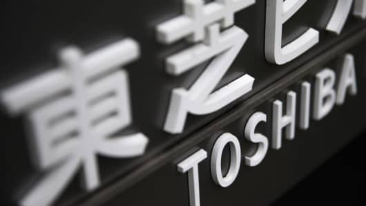 Toshiba signage is displayed at Hamamatsucho Building, which houses the Toshiba headquarters, in Tokyo, Japan, on Tuesday, March 14, 2017.