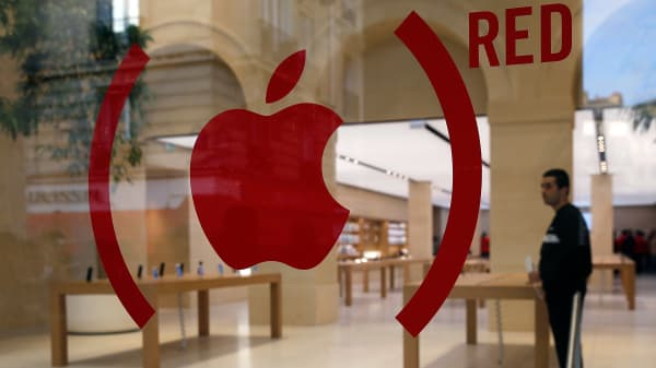 An Apple red logo is displayed for the fight against aids on the facade of the new Apple store. Apple is releasing Special Edition iPhone 7 and Apple Watch in Red.