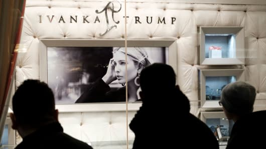 """People walk past the """"Ivanka Trump Collection"""" shop in the lobby at Trump Tower in New York."""
