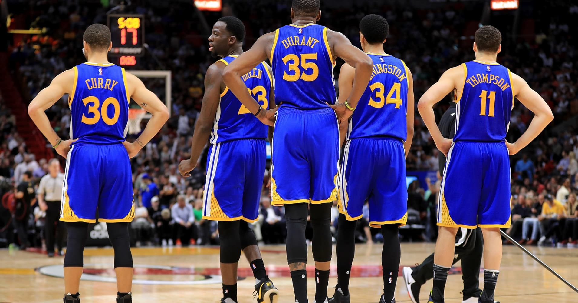 The Golden State Warriors line up during a game against the Miami Heat.