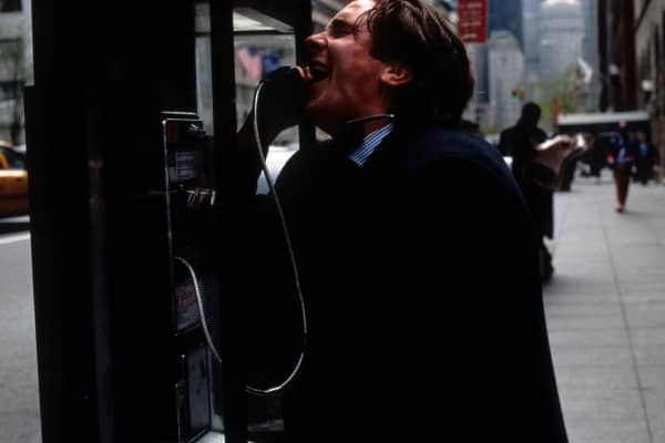 Christian Bale at pay phone in a scene from the film 'American Psycho', 2000.