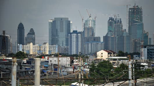 A general view shows under-construction buildings among the city skyline in Jakarta on June 30, 2016.