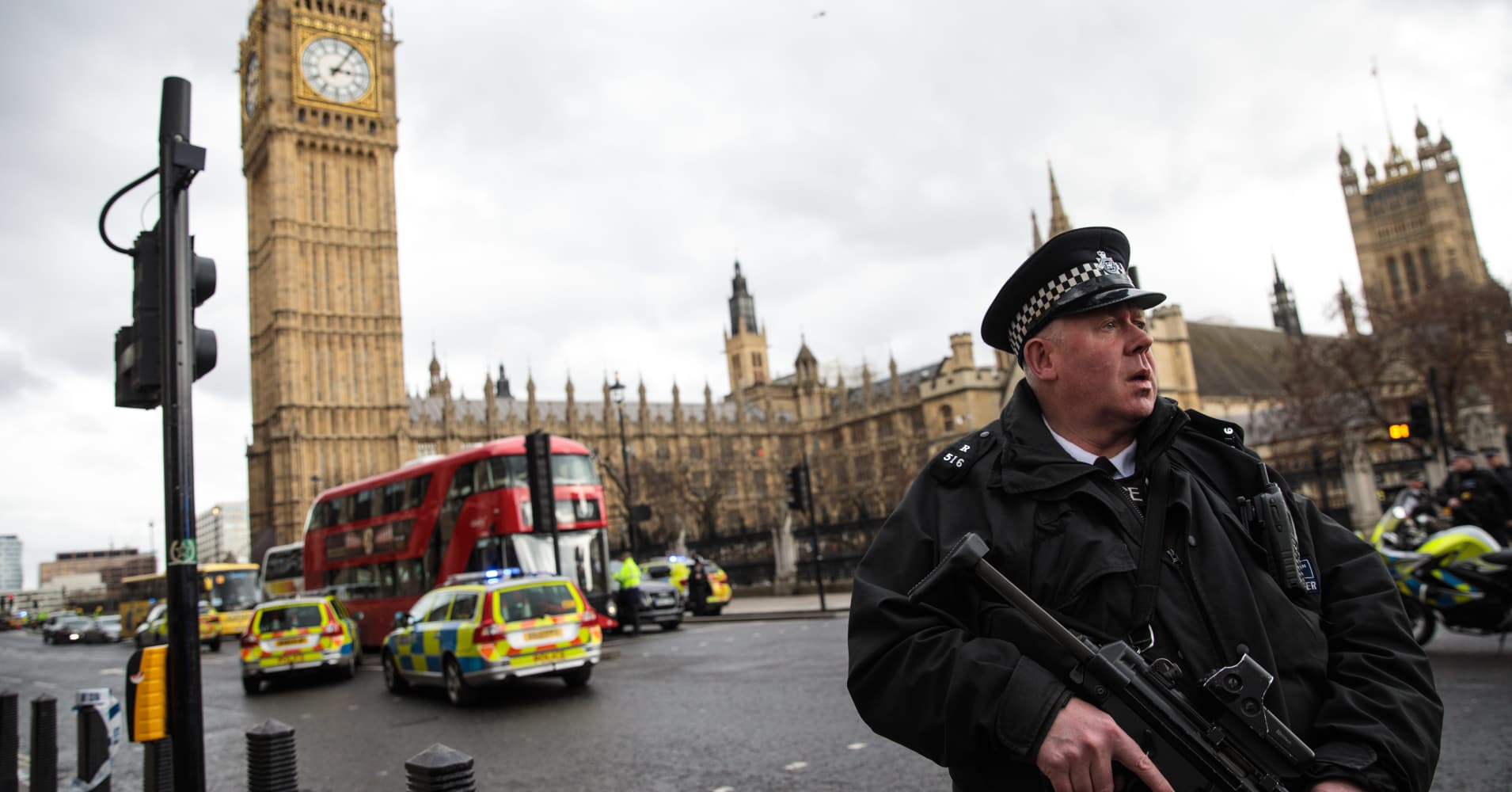 An armed police officer stands guard near Westminster Bridge and the Houses of Parliament on March 22, 2017 in London, England.