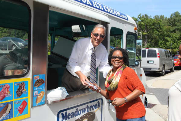 Gordon Krater giving out ice cream to an employee on an ice cream social day at Plante Moran