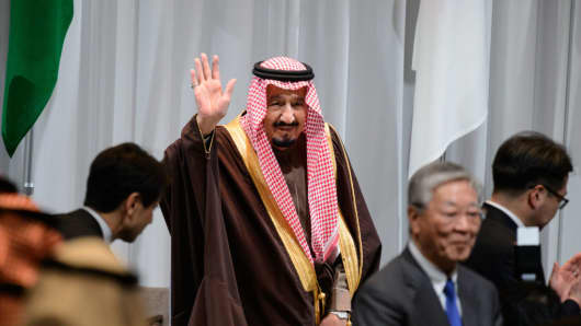 King Salman bin Abdulaziz, Saudi Arabia's king, gestures as he arrives for the Saudi Arabia-Japan Business Forum for Saudi Arabia Vision 2030 in Tokyo, Japan, on Tuesday, March 14, 2017.