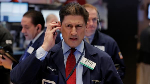 A trader works on the floor of the New York Stock Exchange (NYSE) shortly after the opening bell in New York, U.S., March 22, 2017.