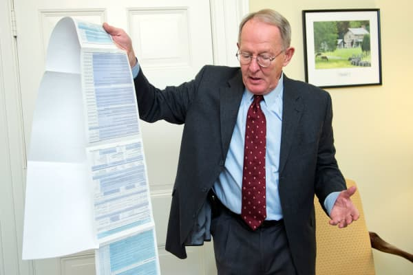 Sen. Lamar Alexander, R-Tenn., shows the Free Application for Federal Student Aid (FAFSA) form on Capitol Hill in Washington, Nov. 14, 2014.